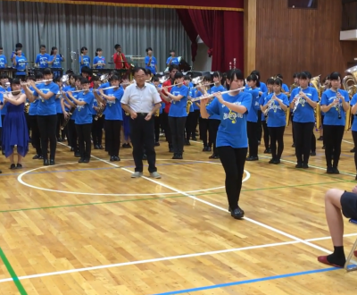 Large group of chinese students playing wind instruments