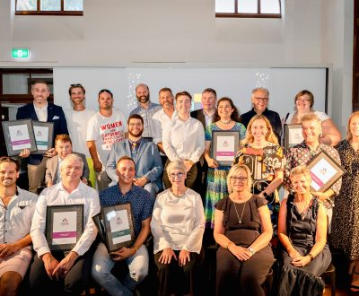 A group picture of award winners and presenters from the Australian Access Awards 2019 on a stage.