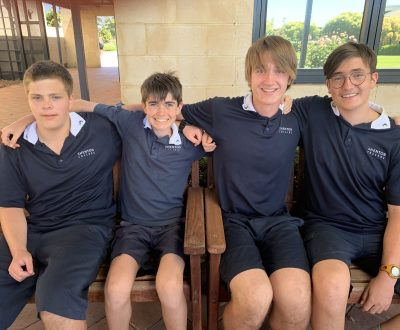 4 year 9 boys sitting with arms around each other