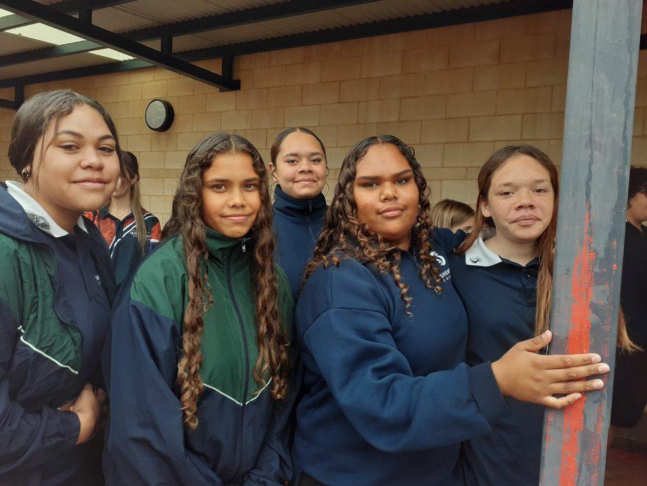 Five female Aboriginal Shenton students face the camera
